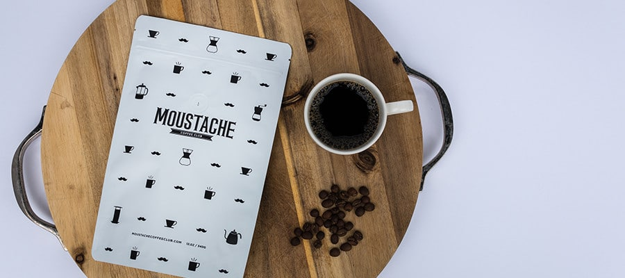 Moustache Coffee Club packaging design with coffee mug.